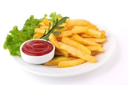french fries: French fries with ketchup closeup over white