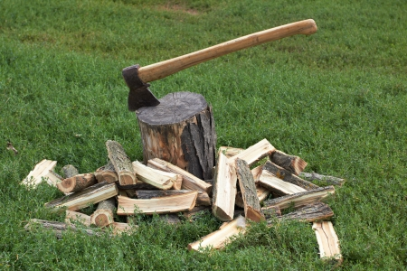 splitting up: Wooden logs and rusty axe  Stock Photo