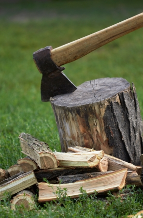 Wooden logs and rusty axe photo