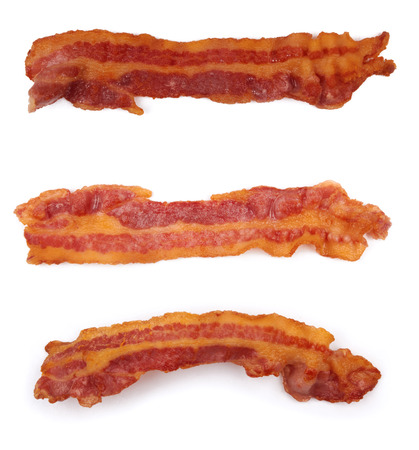 cooked slices of bacon isolated on white