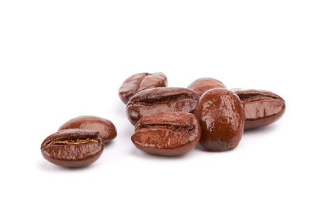 large bean: Brown coffee beans on a white background Stock Photo