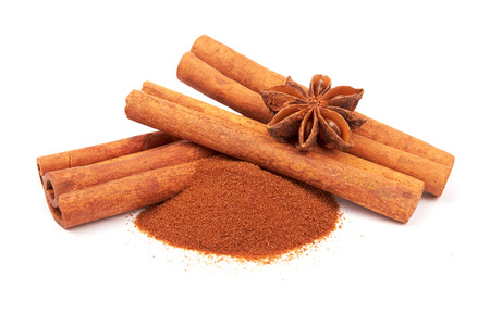 Cinnamon sticks and powder on white background  Imagens