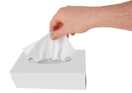 facial tissue: male hand pulling white facial tissue from a box  Stock Photo