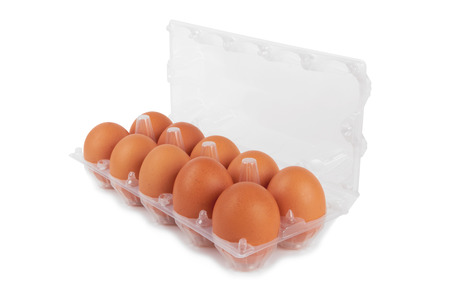 Eggs in plastic box isolated isolated on a white photo