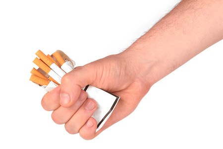 stop smoking fist with crushed pack of cigarettes  photo