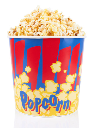 Full bucket of popcorn. Isolated on white background photo