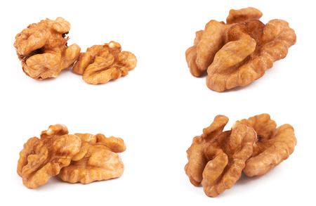 Group of peeled walnuts isolated on a white  photo