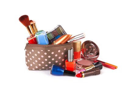 Make up bag with cosmetics and brushes isolated on white  Stock Photo