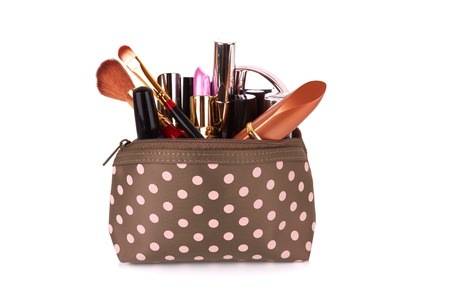 Make up bag with cosmetics and brushes isolated on white  Standard-Bild