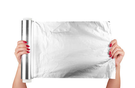 woman holding a roll of aluminum foil  Stock Photo