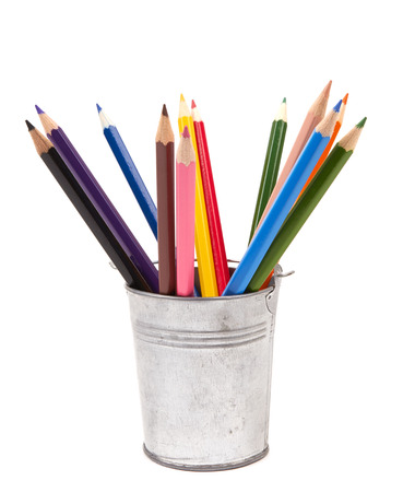Colorful pencils in pail isolated on white background photo