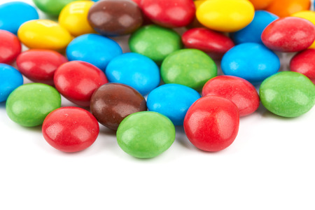 s m: colorful chocolate buttons on a white background
