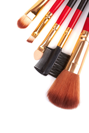 Red cosmetic brushes on a white background photo