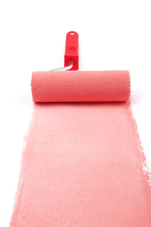 red paint roller: red paint roller isolated on a white background
