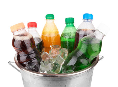 cold beverages: cold beverages in plastic  bottles on heap of ice cubes Stock Photo