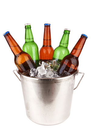 beer bucket: beer bottles in a bucket of ice isolated on a white background.