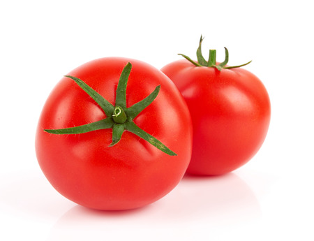 Closeup of tomatoes on the white background Stock Photo