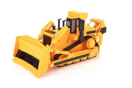 Toy yellow bulldozer on a white background photo