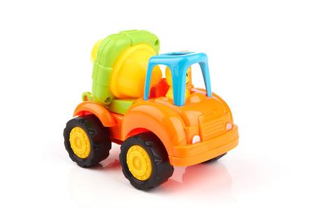 Yellow concrete mixer truck on white background photo