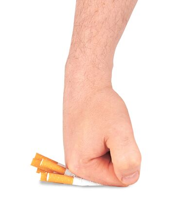 stop smoking fist with crushed cigarettes on white photo
