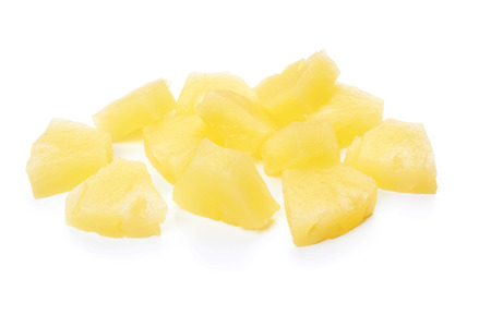 chunks of canned pineapple on white background