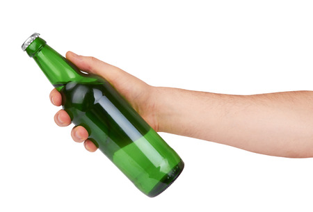 cold beer: hand holding a green beer bottle without label isolated on white background