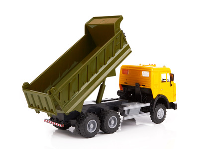 dumptruck: plastic toy truck isolated on white background