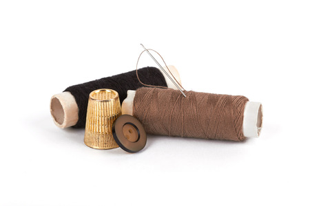 darning needle: thread, needle, button and thimble on isolate white  background