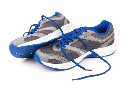 running shoes: pair of running shoes over a white background