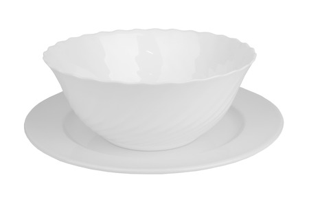 precarious: White bowl on plate isolated on white background