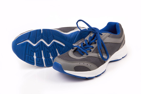 pair of running shoes over a white background photo