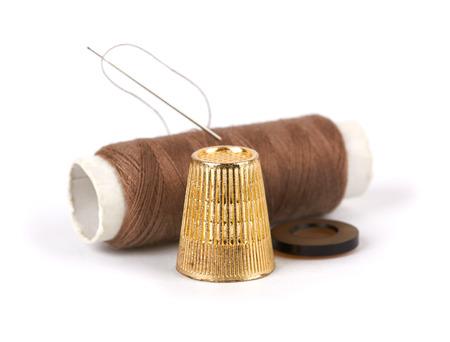 darning needle: thread, needle, button and thimble on isolate white background Stock Photo