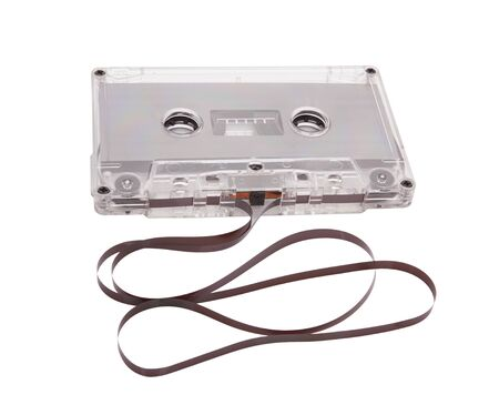Audio cassette with tape tangle on white background photo