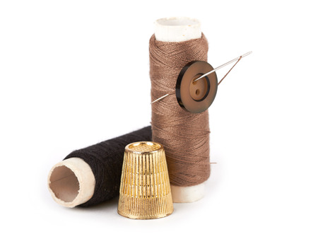 needle and thread: thread, needle, button and thimble on isolate white background Stock Photo