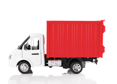 light duty: Toy red truck isolated on a white background