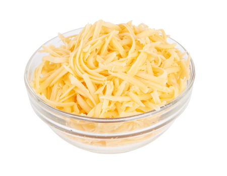 parmesan cheese: Glass bowl of grated cheese isolated on white