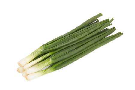 bulb and stem vegetables: Green onions isolated on a white background