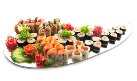 Sushi set . Different types of sushi on mirror isolated on white