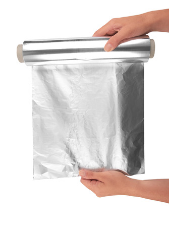 foil roll: woman holding a roll of aluminum foil