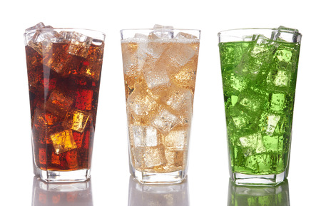 Glasses with sweet drinks with ice cubes isolated on white background