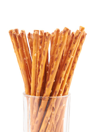 pretzel stick: salted pretzels in a glass isolated on white background
