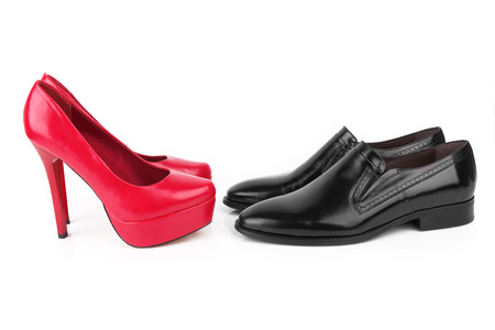 Fashionable mans and womanish shoes isolated on white background