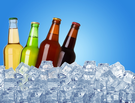4 of a kind: bottles of beer in ice on blue background