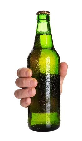 green beer bottle: hand holding a green beer bottle without label isolated on white background