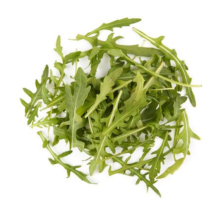 rukola: Pile of fresh arugula green leaves isolated on white background