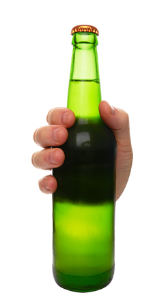 green beer bottle: green beer bottle without label in hand isolated on white background Stock Photo