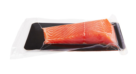 Fillet of salmon vacuum packed isolated on white background Standard-Bild