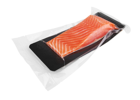 Fillet of salmon vacuum packed isolated on white background Stok Fotoğraf