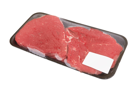 Fresh raw meat in package isolated on white background