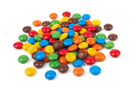 colorful chocolate buttons isolated on a white background